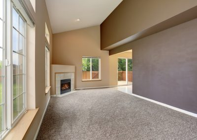 Empty living room interior in light tones and fireplace